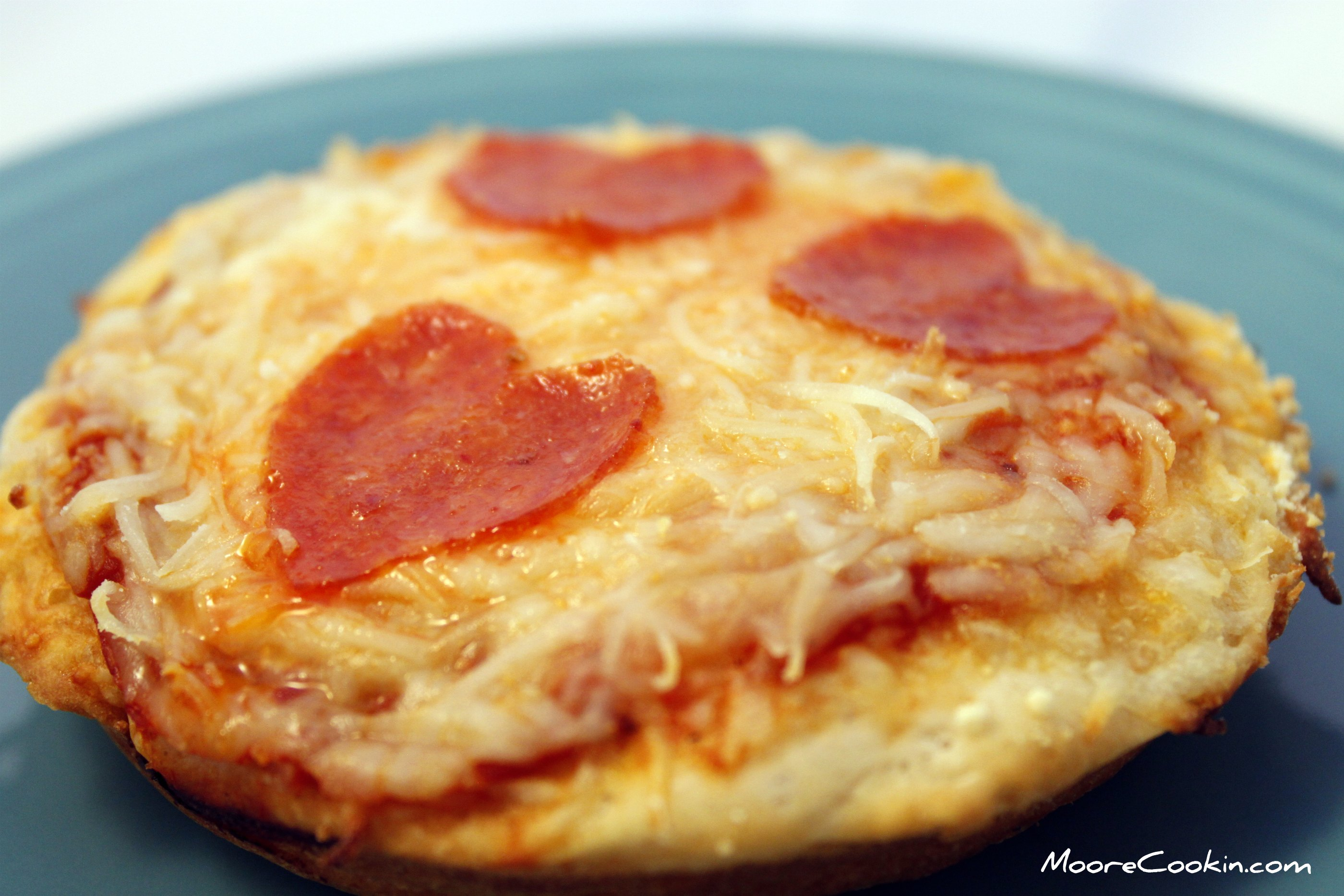 Here is what you will need 1 pan 1 oven 1 can of biscuits, thawed to room temp. 1 jar of Ragu pizzaquick pizza sauce 1 bag of shredded pizza cheese 1 bag of .